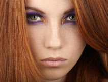 Closeup portrait of young calm beautiful redhead woman with gorgeous hair and violet eyes makeup Royalty Free Stock Image
