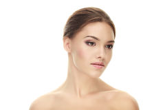 Closeup portrait of young calm brunette woman with trendy makeup posing with bare shoulders on white studio background Stock Photo