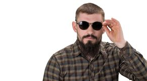 Closeup portrait of a young casual man in sunglasses looking i royalty free stock photography
