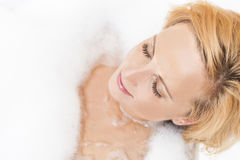 Closeup Portrait of Young Caucasian Blond Female Relaxing in Bathtub Royalty Free Stock Images
