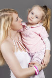 Closeup Portrait of Young Caucasian Female with Little Daughter Stock Image