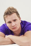 Closeup Portrait of Young Caucasian Handsome Tanned Man Laying D Royalty Free Stock Images