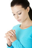 Closeup portrait of a young caucasian woman praying. Isolated on white Stock Photos