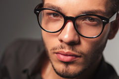 Closeup portrait of a young cute man with glasses Stock Image