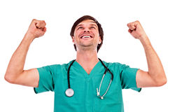 Closeup portrait of a young doctor showing victory gesture Royalty Free Stock Photo