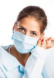 Closeup portrait of a young doctor wearing a mask Stock Image