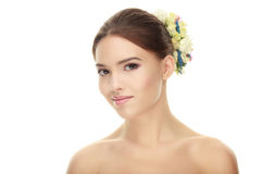 Closeup portrait of young elegant brunette woman with flower headpiece and adorable makeup posing with bare shoulders on white stu Royalty Free Stock Photo