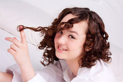 Closeup portrait of young emotional playful girl. With perfect curly hair Stock Photography