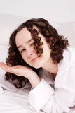 Closeup portrait of young emotional playful girl. With perfect curly hair Stock Photos