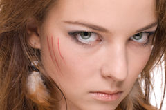 Closeup portrait of young emotional savage woman. On white Royalty Free Stock Image