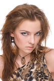 Closeup portrait of young emotional savage woman. On white Royalty Free Stock Photography