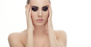 Closeup portrait of young fashionable woman with gorgeous smokey eyes makeup with closed eyes. And bare shoulders Stock Image