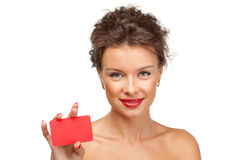 Closeup portrait of young female with blank card Royalty Free Stock Photo