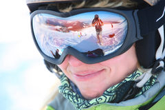 Closeup portrait of a young female skier. Standing on a skiing slope Royalty Free Stock Image