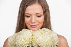 Closeup portrait of young girl with flowers. Royalty Free Stock Image