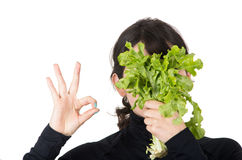 Closeup portrait young girl holding fresh lettuce Stock Photography