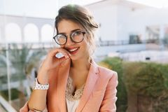 Closeup portrait of young gorgeous girl in stylish glasses, pretty student, business woman wearing elegent pink jacket royalty free stock photo