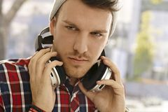 Closeup portrait of young guy with headphones Stock Photo