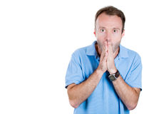 Closeup portrait of a young handsome guy surprised, shocked, scared, with hand covering mouth Stock Photo