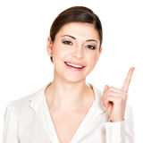 Portrait of the young happy woman points up Stock Image