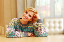 Closeup portrait of young happy woman sitting at the table Stock Images