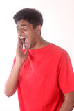 Closeup portrait of young indian man with tooth ache Royalty Free Stock Photos