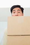 Closeup portrait of a young man carrying boxes Stock Photography