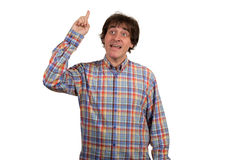Closeup portrait of  young man in checkered shirt pointing finger. Royalty Free Stock Image