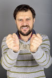 Closeup portrait of a young man with hands handcuffed Stock Image