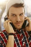 Closeup portrait of young man with headphones Stock Images