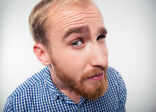 Closeup portrait of a young man looking at camera Stock Photography