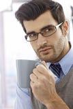 Closeup portrait of young man with mug Royalty Free Stock Photos