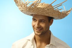 Closeup portrait of young man in straw hat Stock Photos