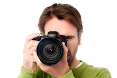 Closeup portrait of a young man taking a picture Stock Photo