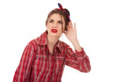 Nosy woman hand to ear gesture, trying carefully royalty free stock photos