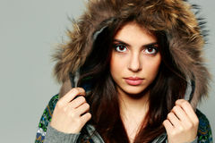 Closeup portrait of a young pensive woman in warm winter outfit Stock Images