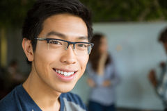 Closeup portrait of young positive asian man Stock Photos