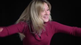 Closeup portrait of young pretty caucasian female dancing happily with excitement in front of the camera.  stock video