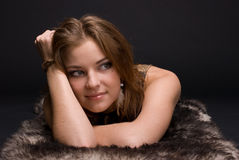 Closeup portrait of young savage woman on fur Stock Photos