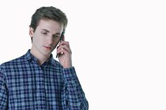 Closeup portrait of young, serious business man, corporate employee, student talking on cell phone. Royalty Free Stock Photos
