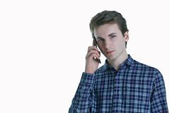 Closeup portrait of young, serious business man, corporate employee, student talking on cell phone. Royalty Free Stock Photo