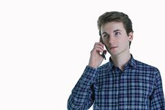 Closeup portrait of young, serious business man, corporate employee, student talking on cell phone. Stock Photography