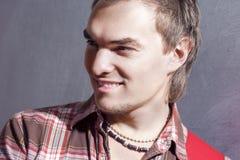 Closeup Portrait of Young Smiling Caucasian Guitar Player Posing Stock Image