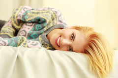Closeup portrait of a young smiling woman lying Royalty Free Stock Images