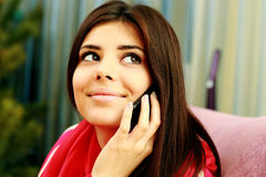 Closeup portrait of a young smiling woman talking on the phone Stock Photography