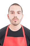 Closeup portrait of young supermarket employee royalty free stock photo