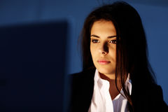 Closeup portrait of a young tired businesswoman working Royalty Free Stock Photos