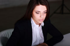 Closeup portrait of a young tired businesswoman working Royalty Free Stock Images