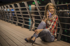 Closeup portrait young unhappy teen woman, talking on cell phone Royalty Free Stock Photos