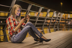 Closeup portrait young unhappy teen woman, talking on cell phone Royalty Free Stock Photo